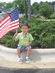 Waving his American flag.