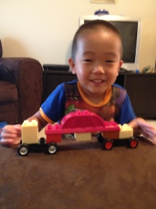 So proud of his 18 wheeler he built all by himself!